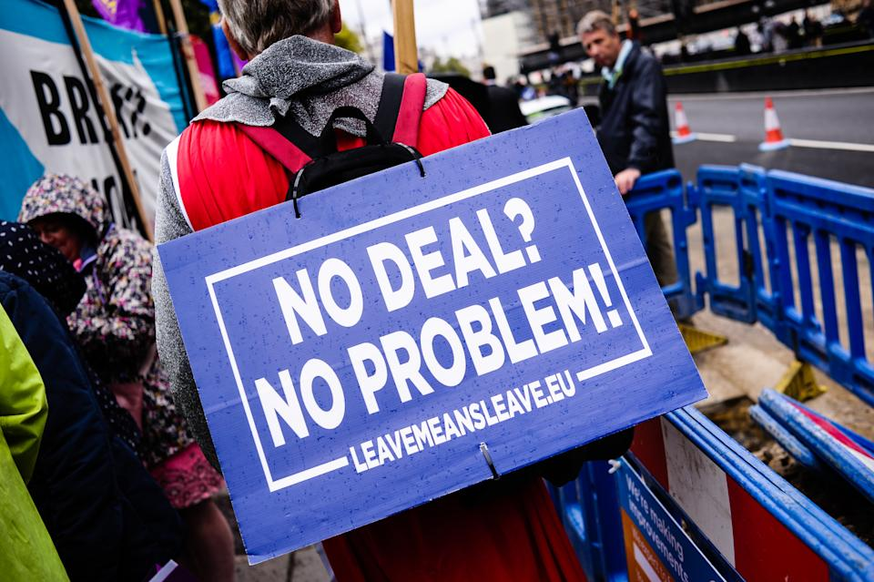 A pro-Brexit activist holds a placard that says No Deal? No Problem!' outside the Houses of Parliament in London on the day of the prorogation of the parliamentary session, which will see parliamentary activities suspended until mid-October. (Photo by David Cliff / SOPA Images/Sipa USA)