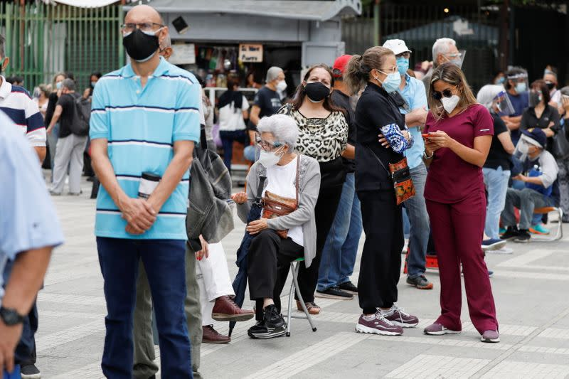 Senior citizens and health workers wait to receive their first dose of Russia's Sputnik V vaccine against the coronavirus disease (COVID-19), in Caracas