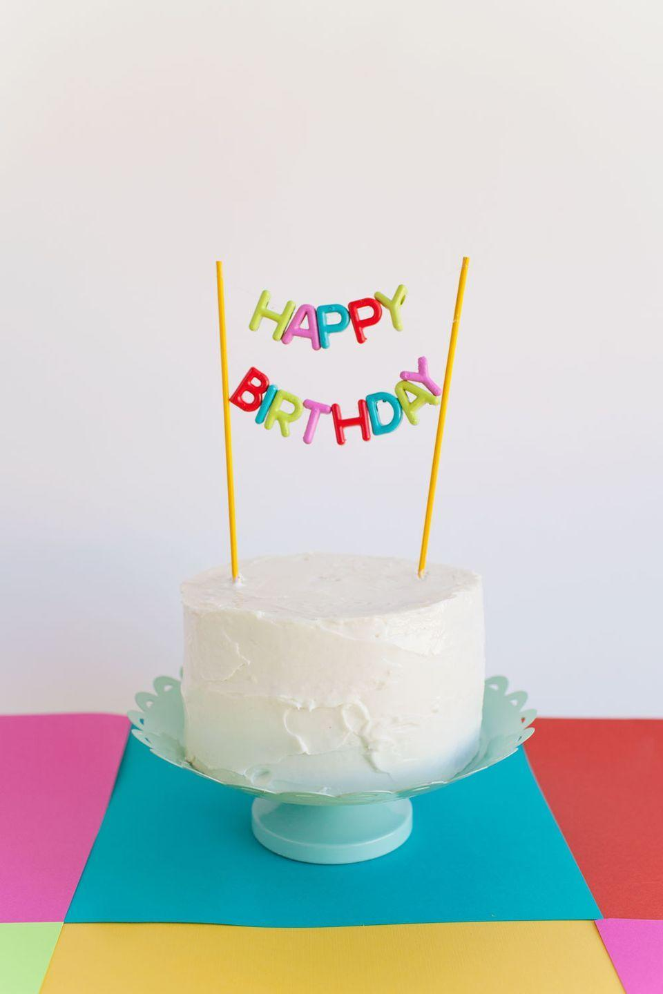 """<p>For a pretty birthday cake topper that gets the message across, all you need is some plastic alphabet beads, skewers, and fishing line. </p><p><strong><em><a href=""""https://tellloveandparty.com/2015/07/alphabet-bead-cake-topper-diy.html"""" rel=""""nofollow noopener"""" target=""""_blank"""" data-ylk=""""slk:Get the tutorial at Tell Love and Party"""" class=""""link rapid-noclick-resp"""">Get the tutorial at Tell Love and Party</a>. </em></strong></p><p><a class=""""link rapid-noclick-resp"""" href=""""https://www.amazon.com/Constructive-Playthings-LER6401-Learning-Resources/dp/B0008GHV7Q?tag=syn-yahoo-20&ascsubtag=%5Bartid%7C10070.g.37055923%5Bsrc%7Cyahoo-us"""" rel=""""nofollow noopener"""" target=""""_blank"""" data-ylk=""""slk:SHOP ALPHABET BEADS"""">SHOP ALPHABET BEADS</a></p>"""