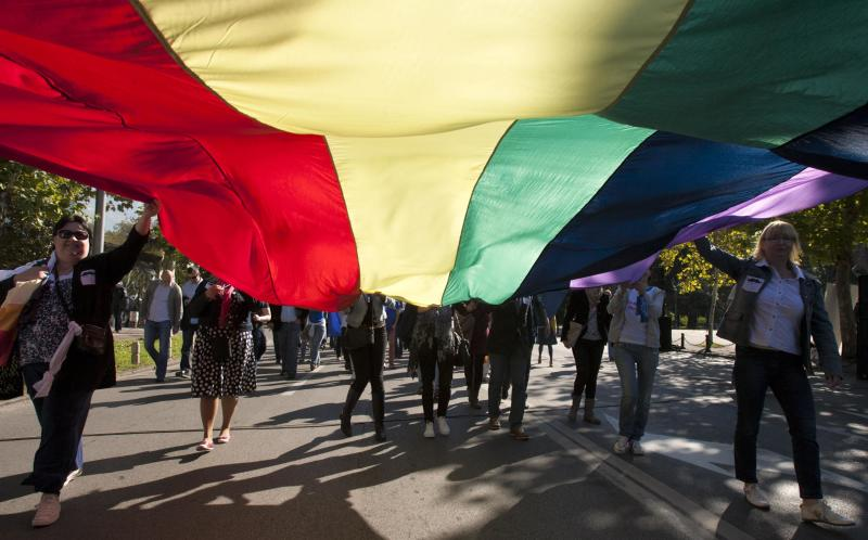 Gay-rights supporters carry a rainbow flag as they walk during a Pride March in Podgorica