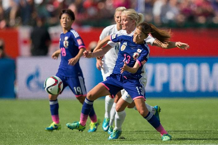 Japan's Rumi Utsugi fights off England's Katie Chapman during the first half of their semifinal at the FIFA Women's World Cup at Commonwealth Stadium in Edmonton, Canada on July 1, 2015 (AFP Photo/Geoff Robins)