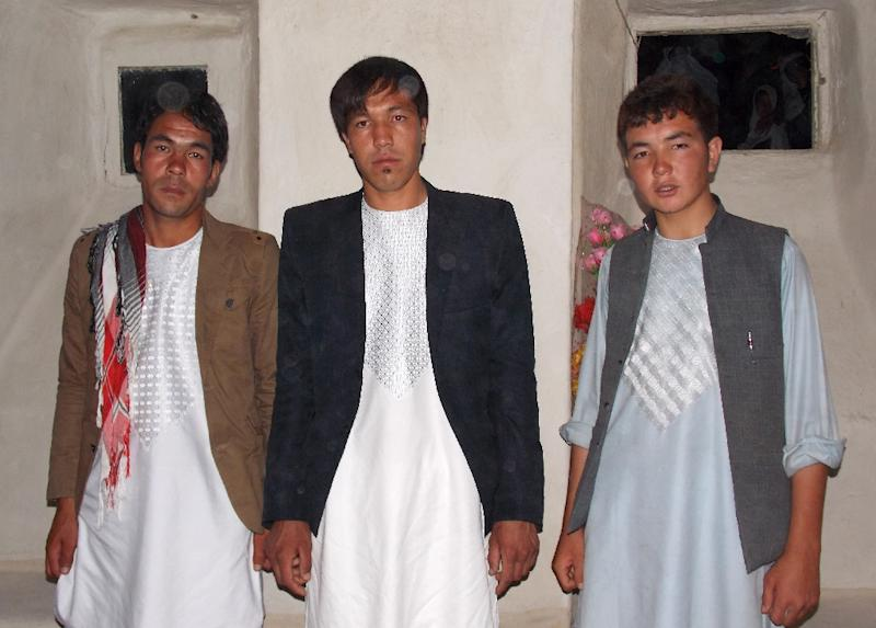 Afghan resident Mohammad Shafi Karimi (C) poses for a photograph with friends in Ghazni before leaving to fight in Syria, where he was killed (AFP Photo/Family of Mohammad Shafi Karimi)