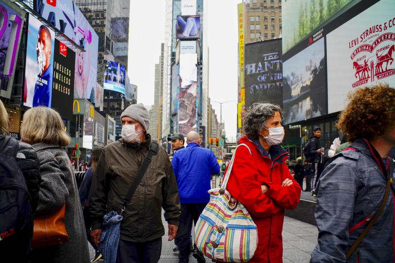 NEW YORK, NEW YORK - MARCH 03 : People wear face masks in Times Square New York on March 03, 2020. New York confirms second coronavirus case, as flights cancelations and Jewish schools close over virus fears.The first person to test positive for coronavirus in the state is a 39-year-old health-care worker who arrived from Iran with her husband, the second one is an attorney who lives in Westchester County, works in Manhattan, Gov. Andrew Cuomo said. (Photo by Eduardo Munoz / VIEWpress via Getty Images)