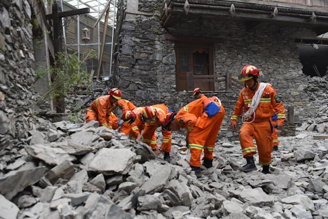 <p>Rescuers search at a hotel after the 7.0-magnitude earthquake at Jiuzhaigou County on Aug. 9, 2017 in Aba Tibetan and Qiang Autonomous Prefecture, Sichuan Province of China. (Photo: VCG via Getty Images) </p>