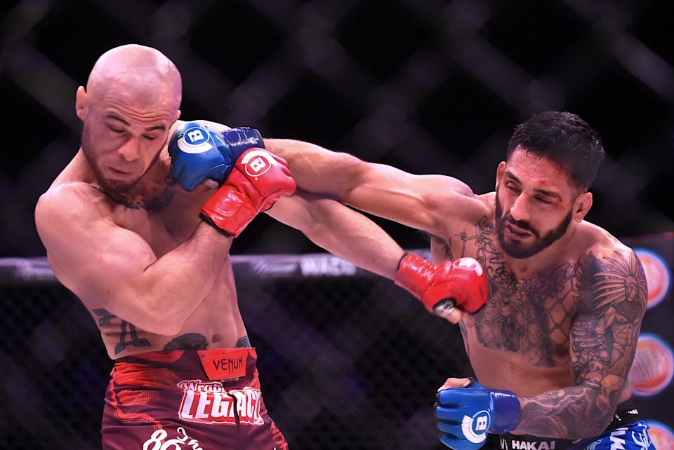 INGLEWOOD, CA - JANUARY 20:  Henry Corrales (blue gloves) and Georgi Karakhanyan (blue gloves) during the their Featherweight fight at Bellator 192 at The Forum on January 20, 2018 in Inglewood, California. Corrales won by unaniomus decision.  (Photo by Jayne Kamin-Oncea/Getty Images)