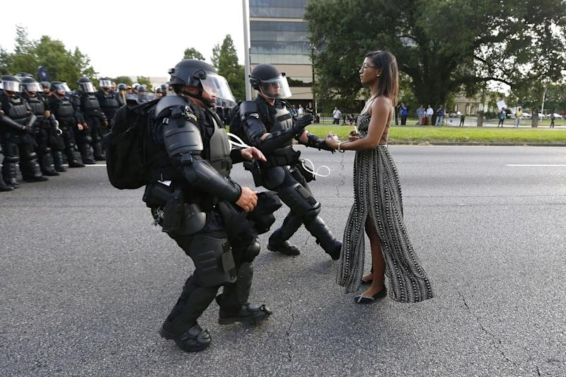 Lone activist Ieshia Evans stands her ground while offering her hands for arrest as she is charged by riot police during a July 2016 protest against police brutality in Baton Rouge, Louisiana. Evans, a 28-year-old Pennsylvania nurse, traveled to Baton Rouge to protest the death of Alton Sterling, a Black father who was shot at close range by two white police officers. (Photo: Jonathan Bachman / Reuters)