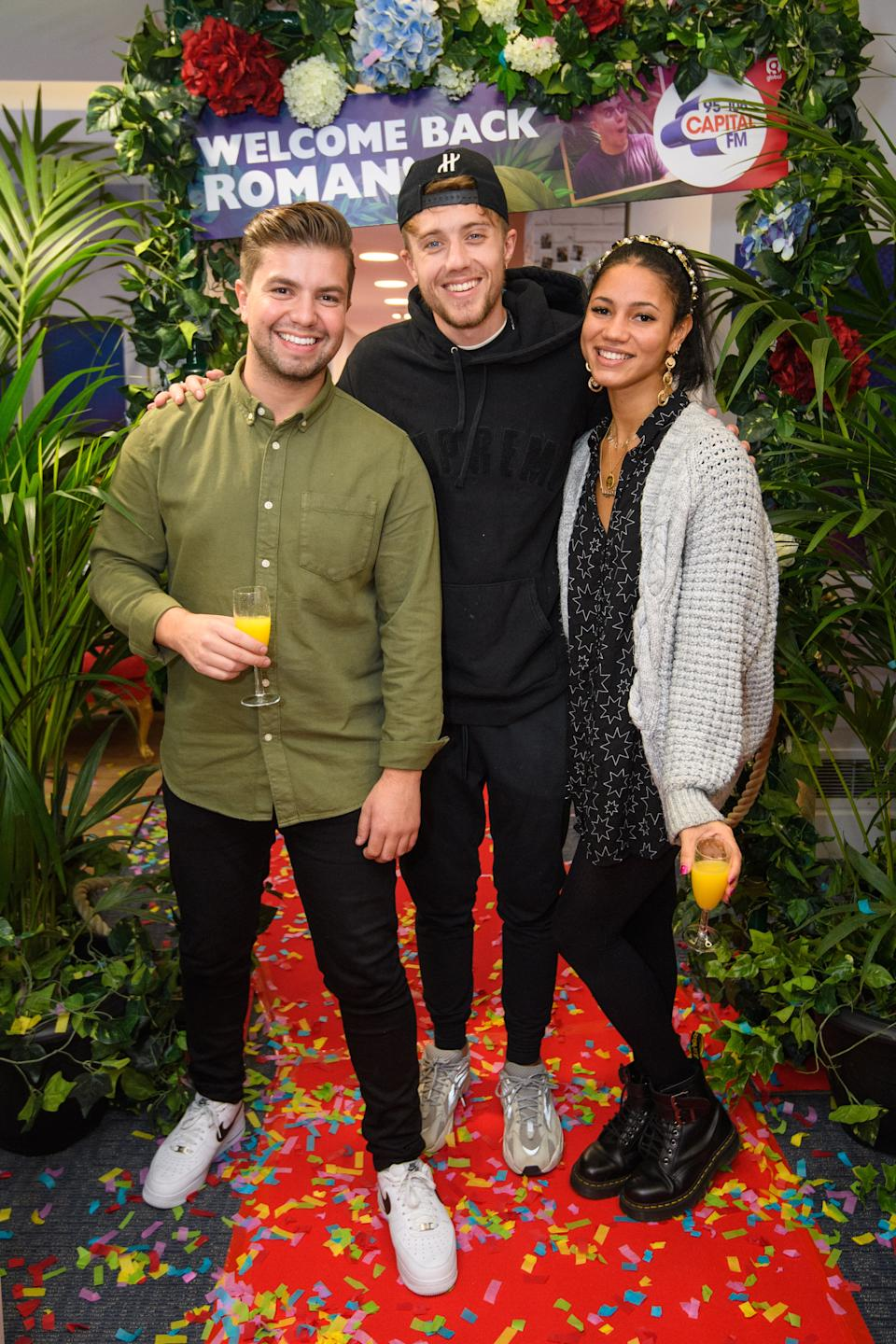 Capital DJ Roman Kemp (centre) is greeted by Sonny Jay and Vick Hope, on his first day back at Capital Breakfast, after coming third in 'I'm A Celebrity... Get Me Out Of Here!'