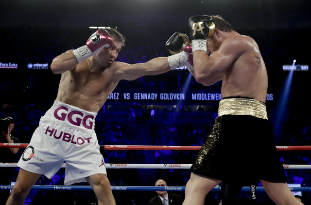 FIle - In this Sept. 15, 2018, file photo, Gennady Golovkin lands a punch against Canelo Alvarez during a middleweight title boxing match, in Las Vegas. Golovkin has been one of his generations best champions. His two bouts with Canelo Alvarez were classics, and a third could be coming later in 2019 if Triple G takes care of Steve Rolls. (AP Photo/Isaac Brekken, File)