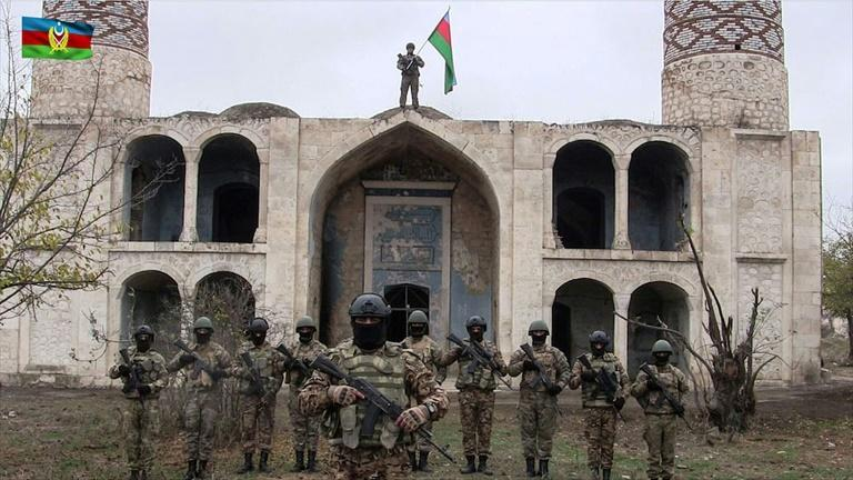 Azerbaijani troops Friday moved into the Aghdam district bordering Nagorno-Karabakh