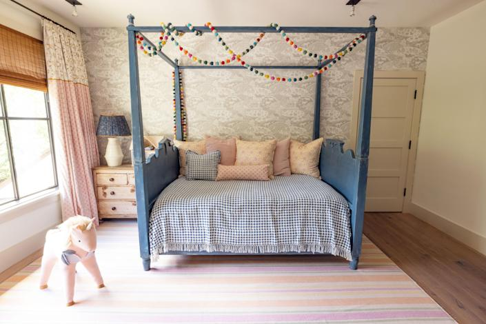 Odette's bed is from Mulligan's; the bedding is from Les Indiennes, Muriel Brandolini, and Lost & Found L.A. The curtains are also by Muriel Brandolini.