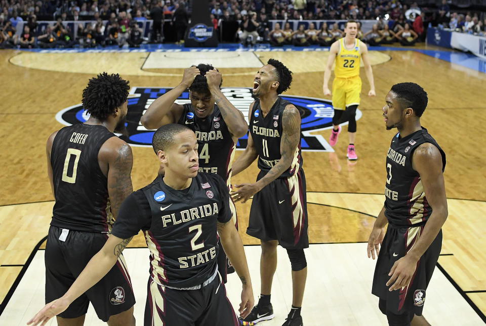 Florida State's Phil Cofer, Terance Mann, Braian Angola, Trent Forrest and CJ Walker, clockwise from left, react after Michigan scored during the second half of an NCAA men's college basketball tournament regional final Saturday, March 24, 2018, in Los Angeles. Michigan won 58-54. (AP Photo/Alex Gallardo)