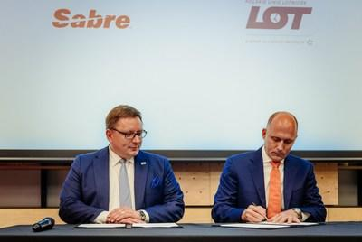 Rafał Milczarski (left), CEO of Polish carrier LOT, and Sean Menke, president and CEO of Sabre, met in a signing ceremony in Poland announcing the companies' new partnership.