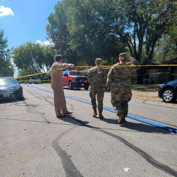 PHOTO: Military personnel walks near the site where a military training aircraft crashed into a residential neighborhood in Lake Worth, Texas, Sept. 19, 2021. (Joni Scarbrough via Reuters)