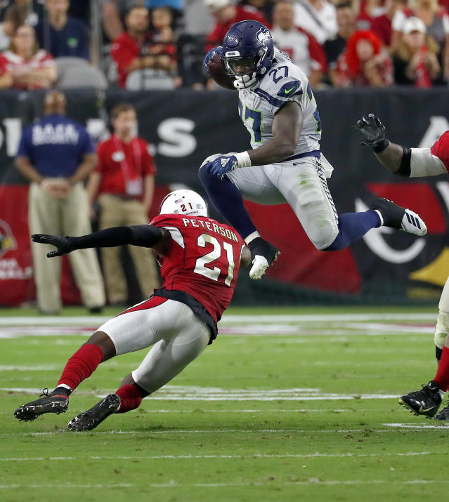 <p>Seattle Seahawks running back Mike Davis (27) leaps over Arizona Cardinals defensive back Patrick Peterson (21) during the second half of an NFL football game, Sunday, Sept. 30, 2018, in Glendale, Ariz. (AP Photo/Rick Scuteri) </p>