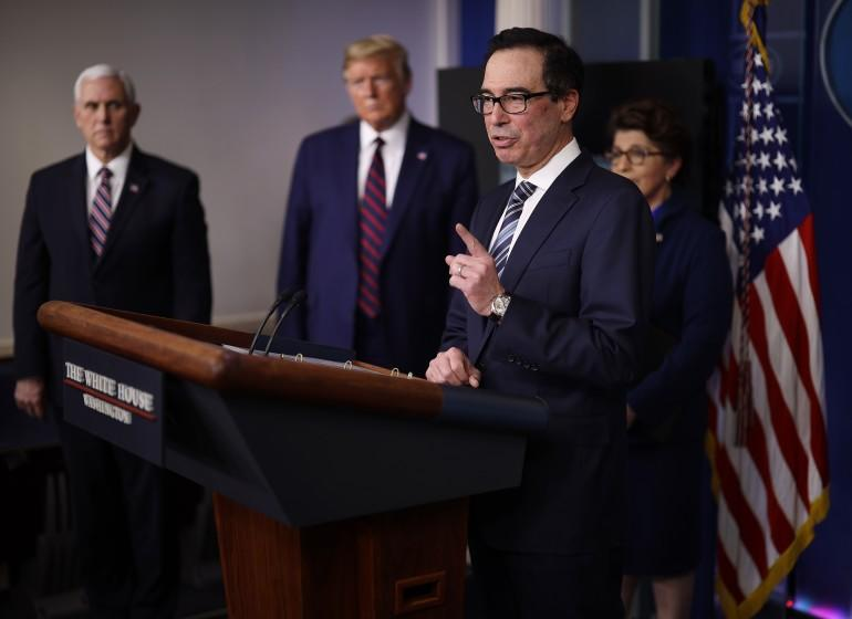 WASHINGTON, DC - APRIL 02: Treasury Secretary Steven Mnuchin speaks in the press briefing room with President Donald Trump, Vice President Mike Pence and Small Business Administrator Jovita Carranza during the Coronavirus Task Force briefing April 2, 2020 in Washington, DC. The U.S. government reported an unprecedented 6.6 million jobless claims this morning as a result of the coronavirus outbreak. (Photo by Win McNamee/Getty Images)