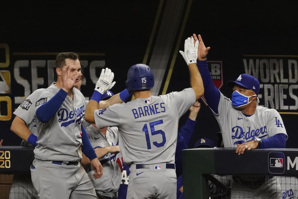 Los Angeles Dodgers' Austin Barnes celebrates a home run during the sixth inning in Game 3 of the baseball World Series against the Tampa Bay Rays Friday, Oct. 23, 2020, in Arlington, Texas. (AP Photo/Tony Gutierrez)