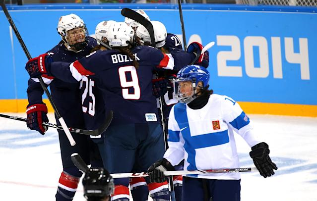 SOCHI, RUSSIA - FEBRUARY 08: Kelli Stack #16 of United States celebrates with her teammate Hilary Knight #21, Alex Carpenter #25 and Megan Bozek #9 after scoring a goal in the second period against Noora Raty #41 of Finland during the Women's Ice Hockey Preliminary Round Group A Game on day 1 of the Sochi 2014 Winter Olympics at Shayba Arena on February 8, 2014 in Sochi, Russia. (Photo by Martin Rose/Getty Images)