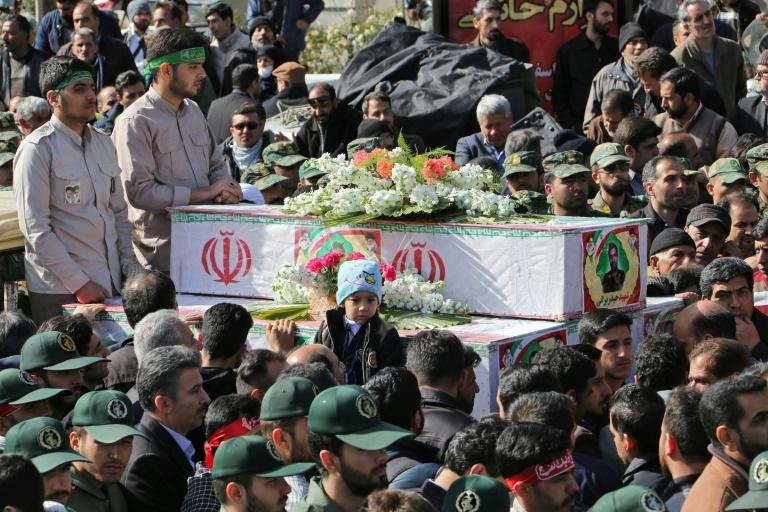 Members of Iran's Revolutionary Guards attend the funeral of fellow guards who were killed in Wednesday's suicide attack