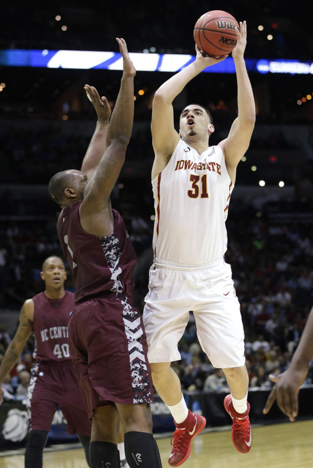 Iowa State forward Georges Niang (31) shoots over North Carolina Central forward Jay Copeland (1) during the first half of a second-round game in the NCAA college basketball tournament Friday, March 21, 2014, in San Antonio. (AP Photo/David J. Phillip)