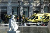 <p>A person is stretched out of a mall by medical staff members in a cordoned off area after a van ploughed into the crowd, injuring several persons on the Rambla in Barcelona on August 17, 2017. (Josep Lago/AFP/Getty Images) </p>