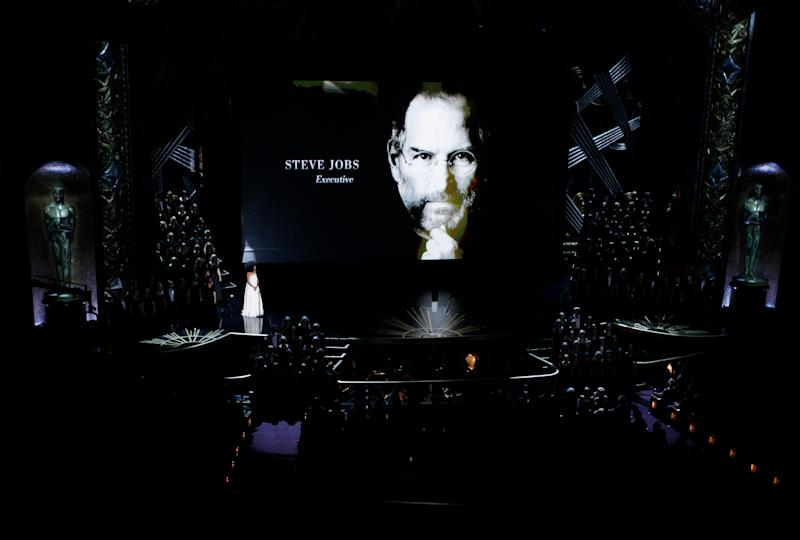 Esperanza Spalding sings as a portrait of Steve Jobs is displayed during the memorial segment at the 84th Academy Awards in Hollywood, California, February 26, 2012. REUTERS/Gary Hershorn (UNITED STATES) (OSCARS-SHOW)