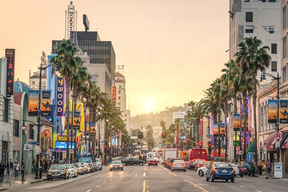 LOS ANGELES - DECEMBER 18, 2013: View of Hollywood Boulevard at sunset. In 1958, the Hollywood Walk of Fame was created on this street as a tribute to artists working in the entertainment industry.; Shutterstock ID 186048416; PO: aol; Job: production; Client: drone