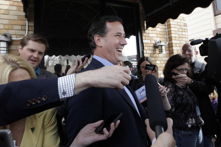 Republican presidential candidate, former Pennsylvania Sen. Rick Santorum, laughs as he answers questions from the media in West Bend, Wis., Sunday, April 1, 2012. (AP Photo/Jae C. Hong)
