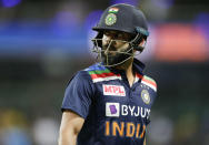 India's Virat Kohli walks from the field after he was dismissed during the one day international cricket match between India and Australia at the Sydney Cricket Ground in Sydney, Australia, Friday, Nov. 27, 2020. (AP Photo/Rick Rycroft)