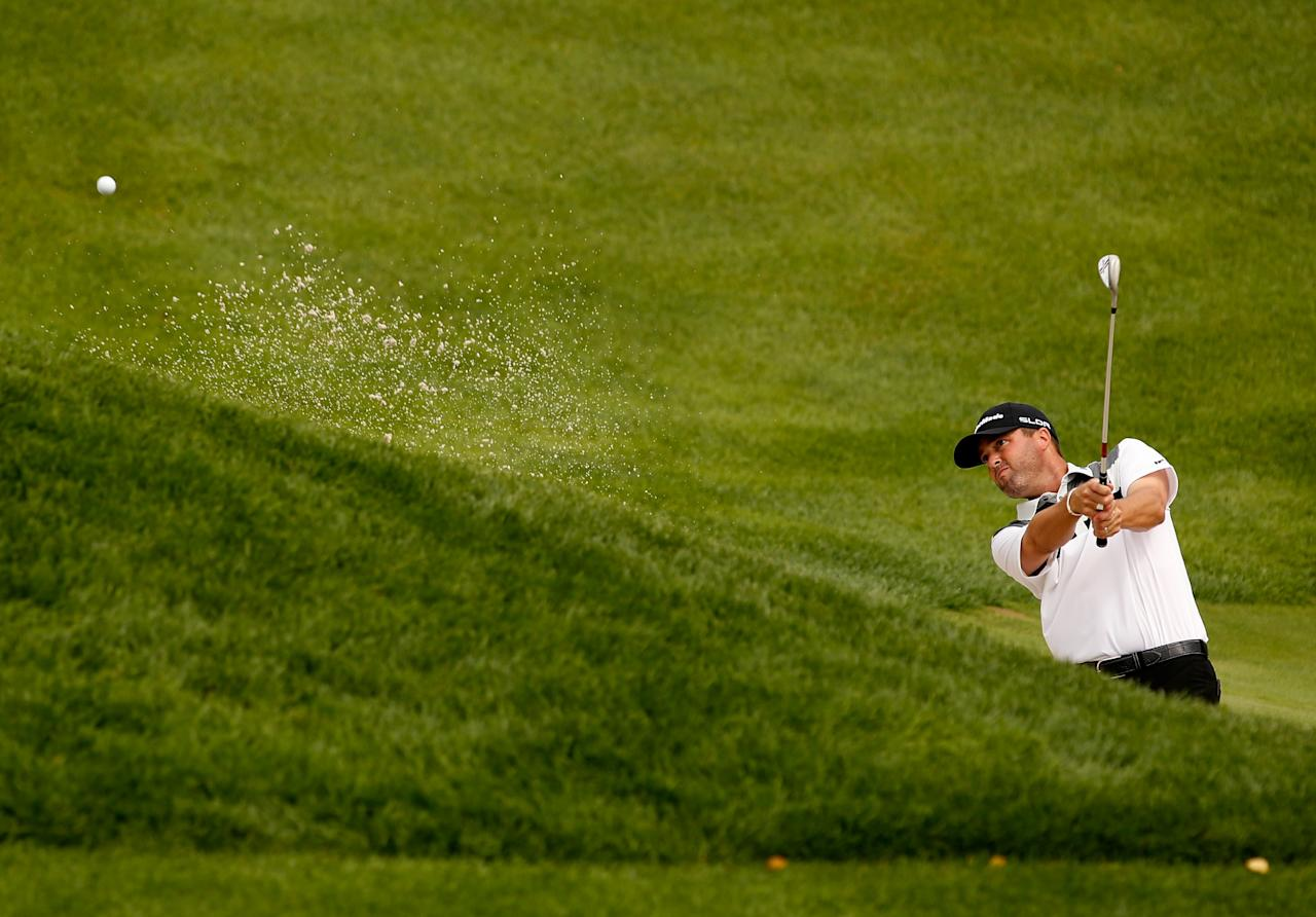 JERSEY CITY, NJ - AUGUST 22: Ryan Palmer of the United States hits his third shot out of the bunker on the fifth hole during the first round of The Barclays at Liberty National Golf Club on August 22, 2013 in Jersey City, New Jersey. (Photo by Darren Carroll/Getty Images)