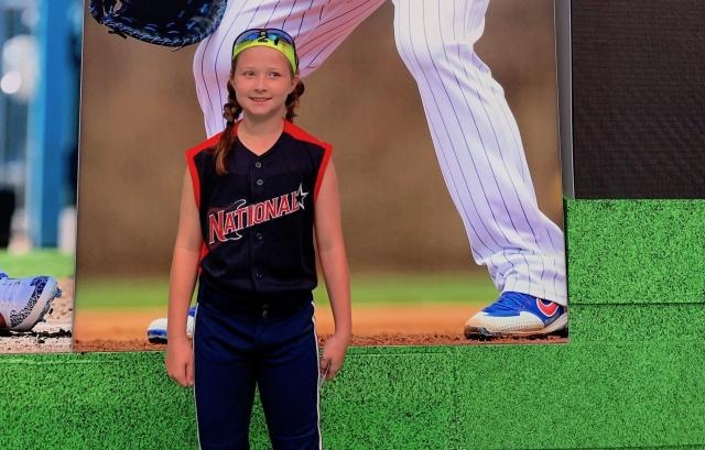 Marie Marcum, the nine-year-old who got a softball insult removed from an MLB throwing game at Chuck E. Cheese, is ready for softball to be as big as Major League Baseball. (Photo: Lisa Marcum)