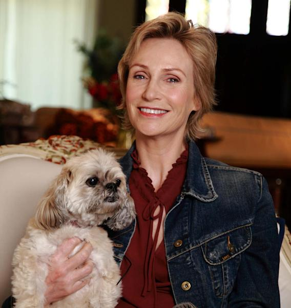 """In this March 9, 2013 photo released by Shelter Me shows series host Jane Lynch posing with Olivia, an Lhasa Apso breed, in Venice, Calif. """"Shelter Me"""" is an inspiring PBS series that celebrates shelter pets with positive and uplifting stories. (AP Photo/Austin Smoak, Shelter Me)"""