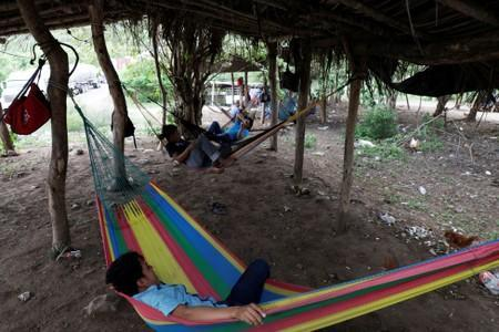 Members of the Community Police rest on hammocks are seen at a checkpoint in the municipality of San Diego Xayakalan