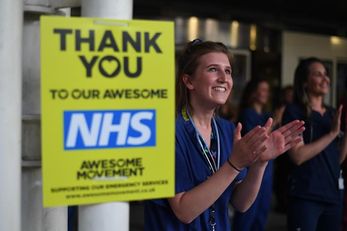 Medical staff outside the Chelsea and Westminster Hospital taking part in Clap for Carers in May. (PA)
