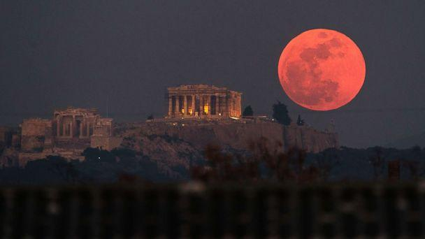 PHOTO: A super blue blood moon rises behind the 2,500-year-old Parthenon temple on the Acropolis of Athens, Greece, on Jan. 31, 2018. (Petros Giannakouris/AP)