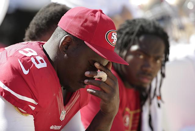 FILE - In this Aug. 17, 2014, file photo, San Francisco 49ers linebacker Aldon Smith (99) sits on the sideline during the second half of an NFL preseason football game against the Denver Broncos in Santa Clara, Calif. Aldon Smith has been suspended for nine games by the NFL after a series of off-field legal issues. A statement Friday, Aug. 29, 2014, from the league said Smith had violated the NFL's substance abuse and personal conduct policies. (AP Photo/Marcio Jose Sanchez)