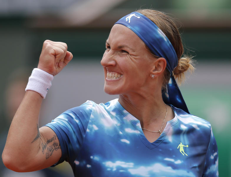Svetlana Kuznetsova, of Russia, reacts as she plays Germany's Angelique Kerber during their fourth round match of the French Open tennis tournament at the Roland Garros stadium Sunday, June 2, 2013 in Paris. (AP Photo/Christophe Ena)