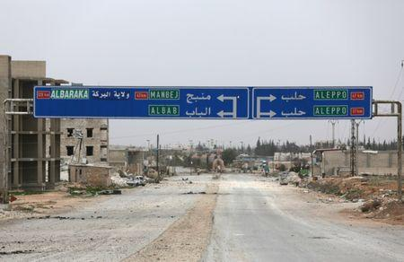 A road sign that shows the direction to Manbij city is seen in the northern Syrian town of al-Bab