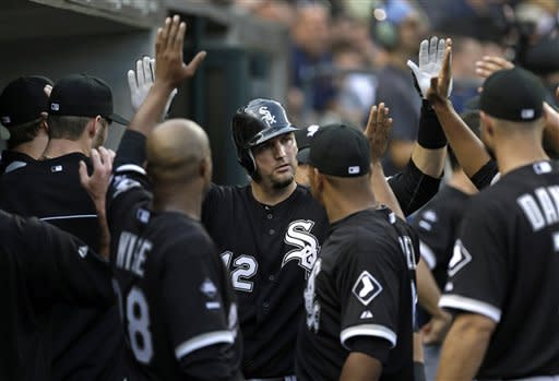 Chicago White Sox's A.J. Pierzynski celebrates his solo home run against the Detroit Tigers in the second inning of a baseball game in Detroit, Friday, Aug. 31, 2012. (AP Photo/Paul Sancya)