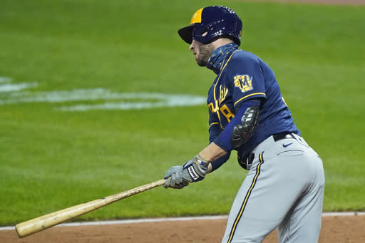 Milwaukee Brewers' Ryan Braun hits an RBI-single in the seventh inning in a baseball game against the Cleveland Indians, Friday, Sept. 4, 2020, in Cleveland. (AP Photo/Tony Dejak)