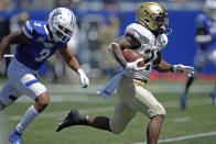 FILE - Army running back Tyrell Robinson, right, outruns Georgia State safety Chris Bacon (3) for a touchdown in the third quarter of an NCAA football game in Atlanta, in this Saturday, Sept. 4, 2021, file photo. No team in the country runs the ball a greater percentage of the time than Army. No team does a better job of stopping the run than Wisconsin. That sets up an intriguing matchup Saturday night, Oct. 16. (AP Photo/Ben Margot, File)