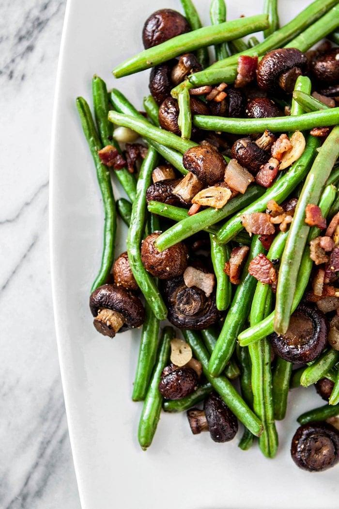 "<p>Did someone say garlic and bacon in the same sentence?! These sautéed green beans will definitely steal the side dish show.</p> <p><strong>Get the recipe</strong>: <a href=""http://www.goodlifeeats.com/garlic-bacon-sauteed-green-beans-with-roasted-mushrooms/"" class=""link rapid-noclick-resp"" rel=""nofollow noopener"" target=""_blank"" data-ylk=""slk:garlic bacon sautéed green beans with roasted mushrooms"">garlic bacon sautéed green beans with roasted mushrooms</a></p>"