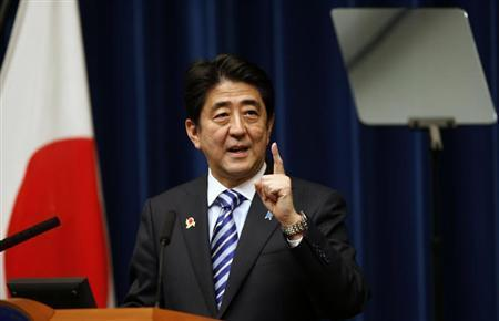 Japan's Prime Minister Shinzo Abe looks at a prompter as he speaks during a news conference to wrap up the ASEAN-Japan Commemorative Summit Meeting at his official residence in Tokyo December 14, 2013. REUTERS/Toru Hanai