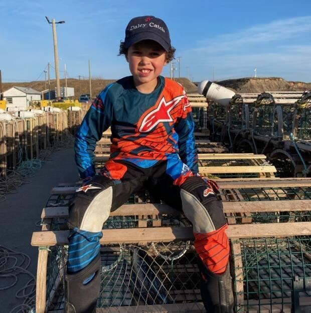A Grade 2 student at Janeville Elementary School in Bathurst, Trent Collins skipped classes on Tuesday to work alongside his grandfather on opening day of lobster season. (Submitted by Alysa Collins - image credit)