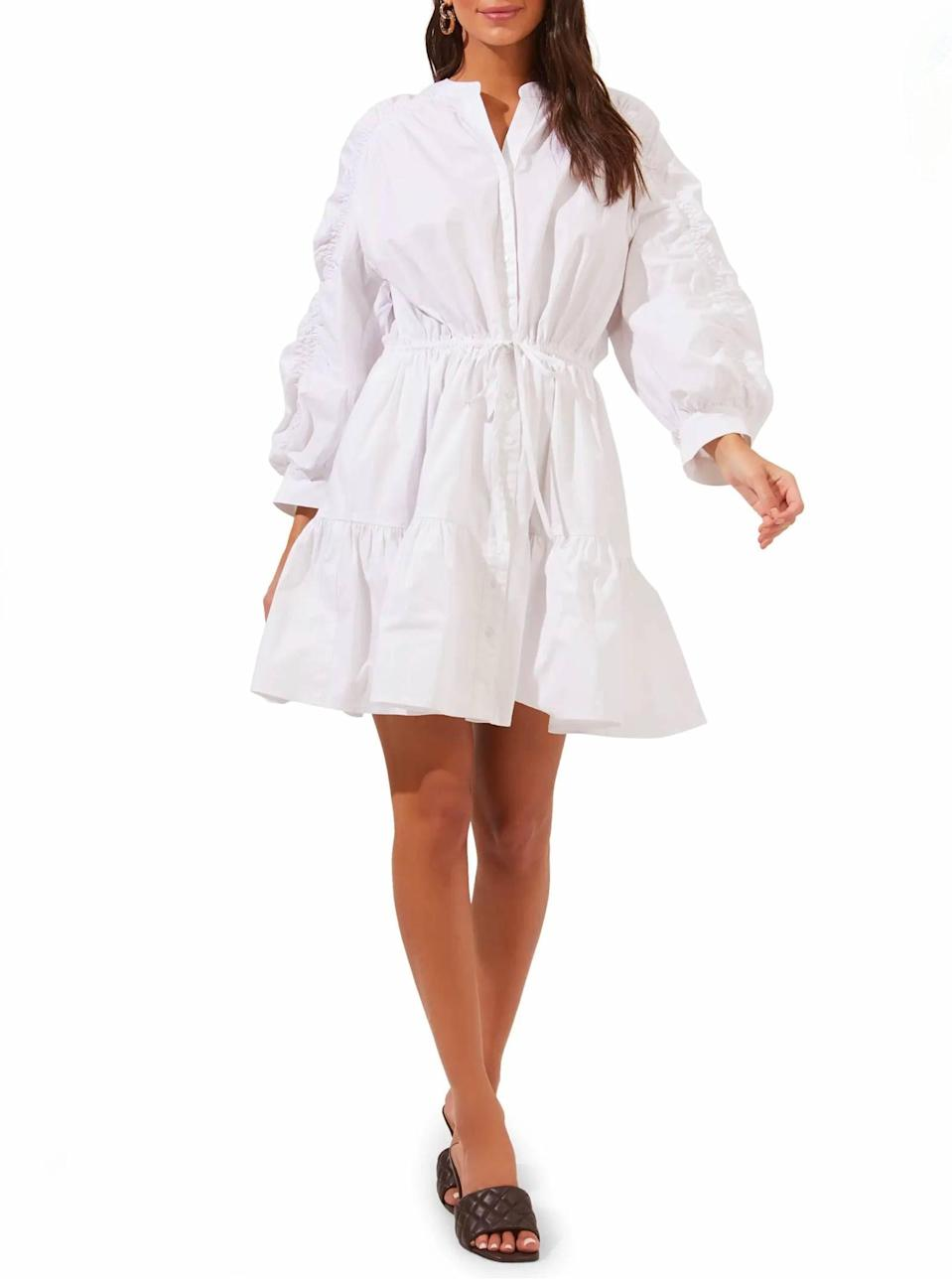 """Don't forget about the little <em>white</em> dress. This floaty option is perfect or brunch and <a href=""""https://www.glamour.com/story/picnic-essentials?mbid=synd_yahoo_rss"""" rel=""""nofollow noopener"""" target=""""_blank"""" data-ylk=""""slk:picnics"""" class=""""link rapid-noclick-resp"""">picnics</a> alike. $54, Nordstrom. <a href=""""https://www.nordstrom.com/s/astr-the-label-ruched-shirtdress/5907406"""" rel=""""nofollow noopener"""" target=""""_blank"""" data-ylk=""""slk:Get it now!"""" class=""""link rapid-noclick-resp"""">Get it now!</a>"""