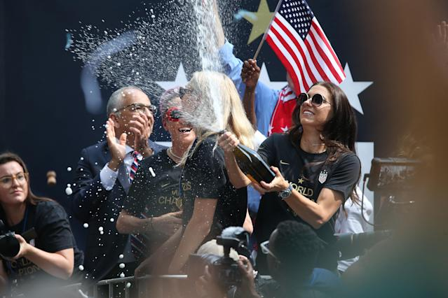 Megan Rapinoe, Allie Long and Alex Morgan celebrate during a Victory Ticker Tape Parade for the U.S. Women's National Soccer Team down the Canyon of Heroes on July 10, 2019 in the Manhattan borough of New York City. The USA defeated the Netherlands on Sunday to win the 2019 FIFA Women's World Cup France. (Photo by Michael Owens/Getty Images)