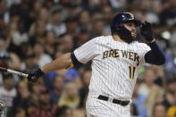 Milwaukee Brewers' Rowdy Tellez watches his RBI single during the fourth inning of the team's baseball game against the Chicago White Sox on Friday, July 23, 2021, in Milwaukee. (AP Photo/Aaron Gash)