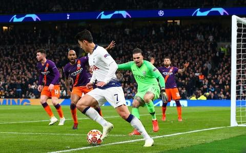 Heung-Min Son of Tottenham Hotspur just manages to keep the ball in play in the build-up to his goal during the UEFA Champions League Quarter Final first leg match between Tottenham Hotspur and Manchester City - Credit: GETTY IMAGES