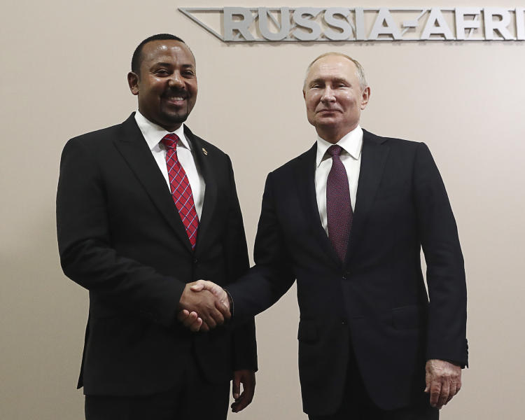 Russian President Vladimir Putin, right, and Ethiopian Prime Minister Abiy Ahmed pose for a photo prior to their talks on the sideline of Russia-Africa summit in the Black Sea resort of Sochi, Russia, Wednesday, Oct. 23, 2019. (Sergei Fadeyechev, TASS News Agency Pool Photo via AP)