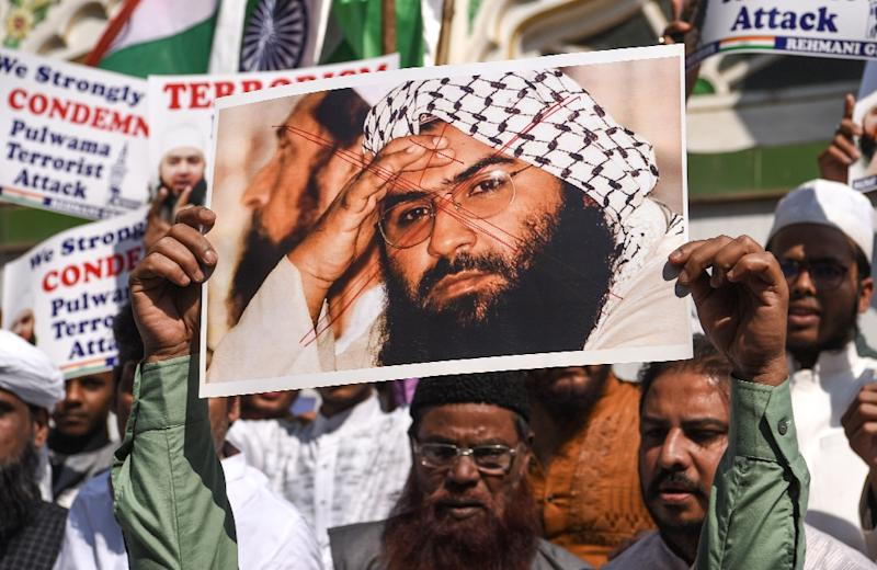 Indian protesters hold a photo of Jaish-e-Mohammad leader Masood Azhar during a protest in Mumbai on February 15, the day after an attack in Kashmir that killed 40 Indian police