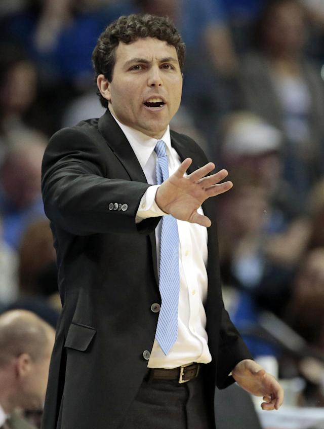 Memphis head coach Josh Pastner directs his players during the first half of an NCAA college basketball game against Cincinnati Saturday, Jan. 4, 2014, in Memphis, Tenn. (AP Photo/Mark Humphrey)
